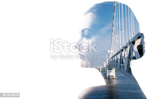 904420364istockphoto Double exposure of young woman and building exterior. 907916876