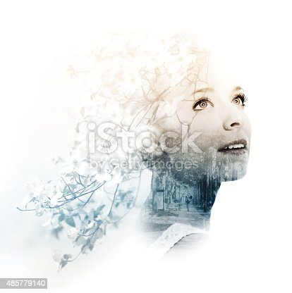 istock Double exposure of young woman with street and doogwood 485779140