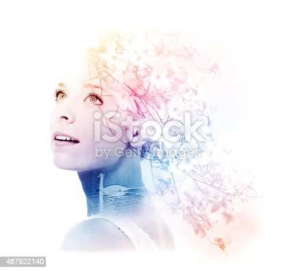 istock Double exposure of young woman with swan and dogwood 487922140