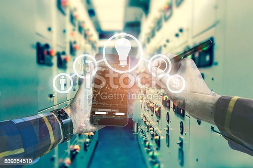 995213208 istock photo Double exposure photo, hand touching mobile phone for using business tool icons,Investment manager with electrical room background for stock trading concept. 839354510