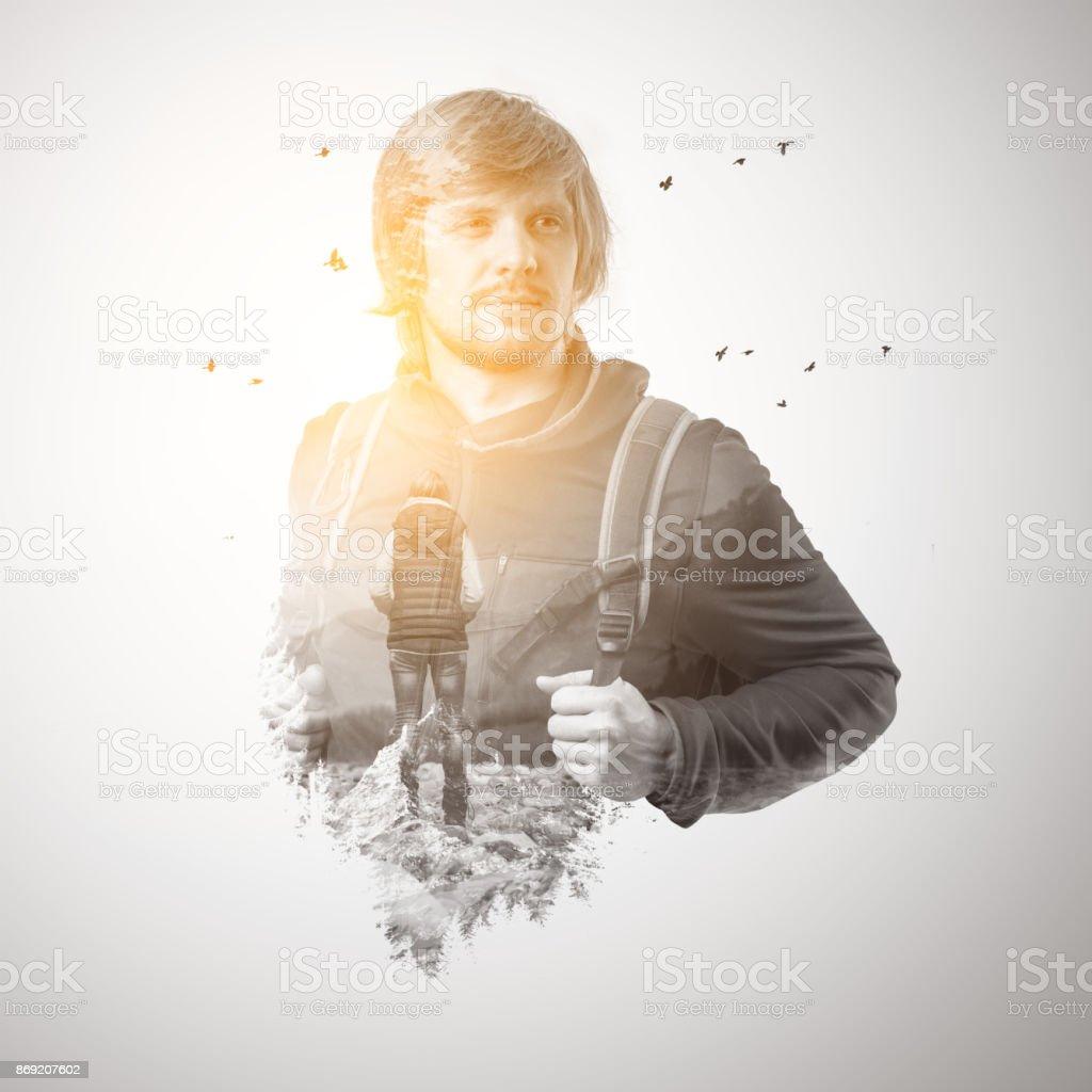 Double exposure portrait of a male traveler. stock photo