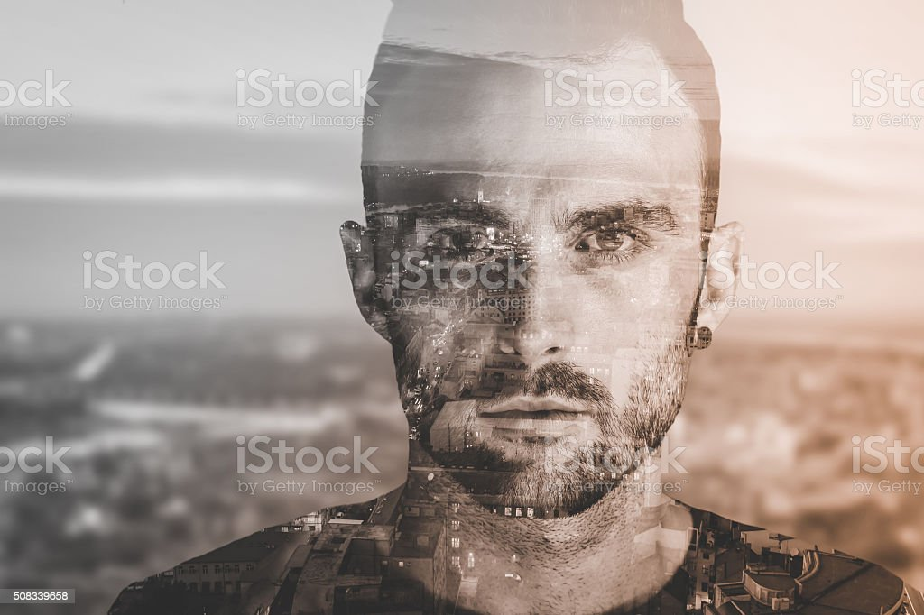 Double exposure portrait of a man and city stock photo
