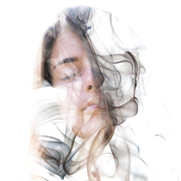 Double exposure portrait of a sensual model combined with a smoky texture behind which she hides or dissolves stock photo