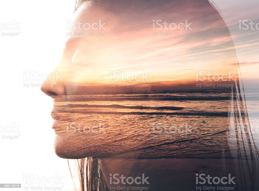 Double exposure portrait of a woman and the beach stock photo