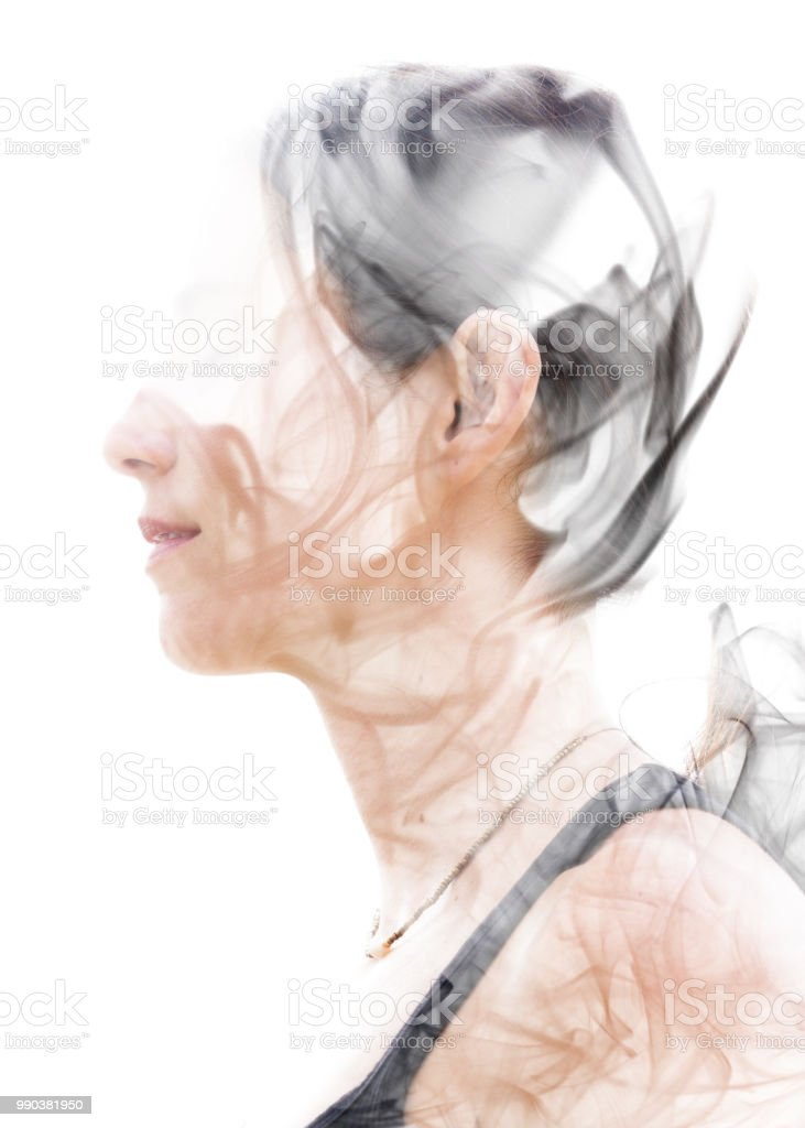 Double exposure portrait of a young woman and a smoky texture stock photo