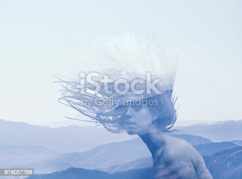 istock double exposure portrait of young girl and blue mountains 916057768