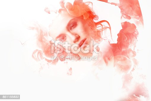 istock Double exposure portrait of young woman and cloud of red ink. 851155832