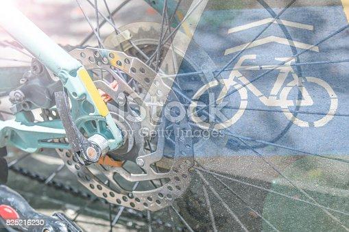 171150458istockphoto double exposure wheel bike with bike sign on the bike path 825216230