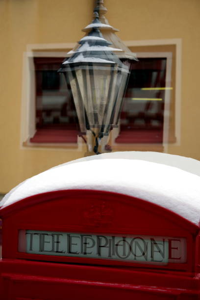 double exposure with red telephone box and street lamp - double exposure стоковые фото и изображения