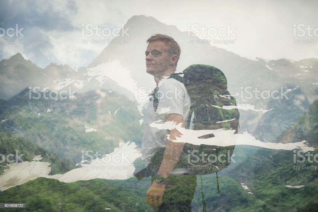 Double exposure with tourist and mountains. Concept and idea of travel stock photo