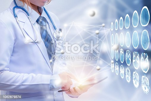 688358418istockphoto double exposure woman doctor holding tablet or smart phone 1052879374