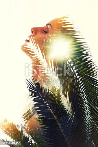 624717328 istock photo Double exposure woman face combined with palm tree leaves 1223649957