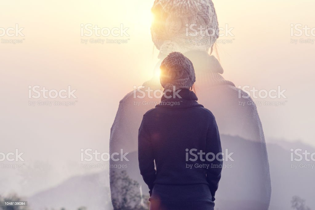 Double exposure, Woman in mountains with sunrise and sunlight effect, Rear view - Zbiór zdjęć royalty-free (Aktywny tryb życia)