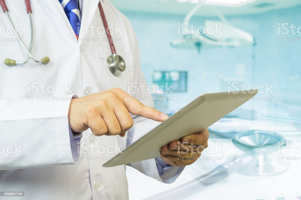 Double exposure,Healtcare,medical,Doctor use tablets computer,Medical Diagnosis And prepare for surgery,doctor recording in Digital clipboard,Health Check support for patient,selective focus stock photo