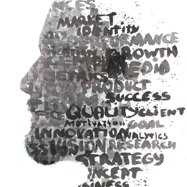 Double exposure.Paintography. Profile portrait of a young male combined with hand drawn painting of words such as market, growth, quality, strategy written in black ink stock photo