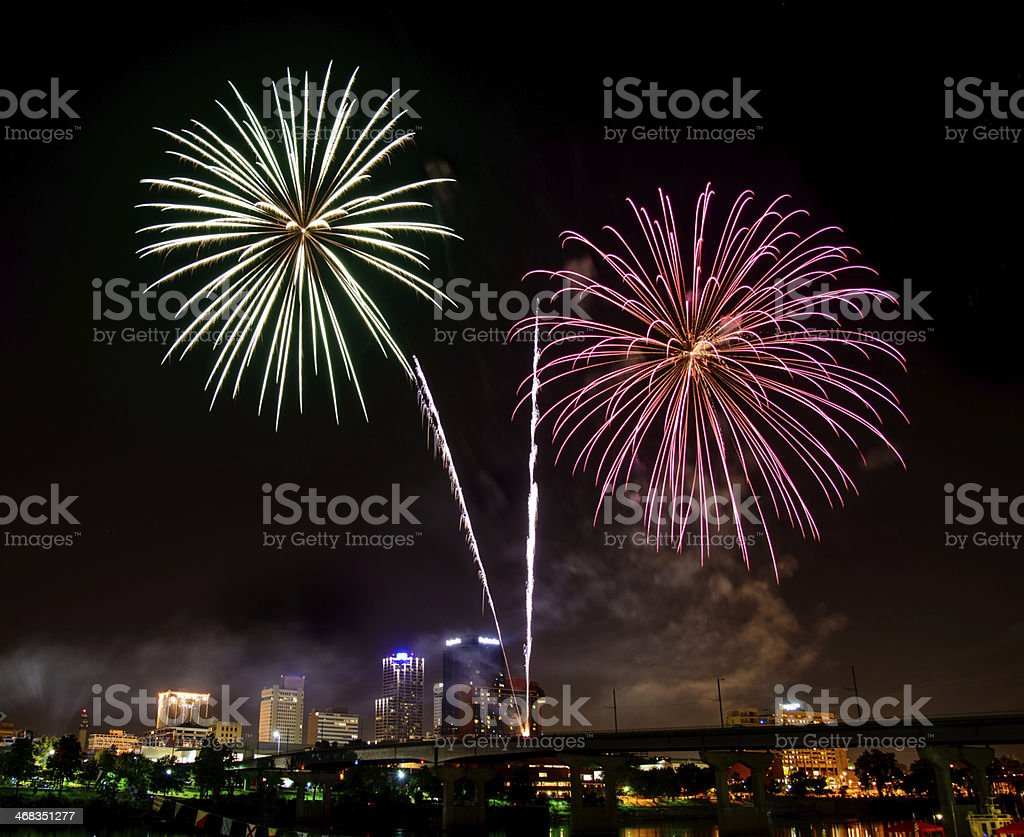 Double fireworks over city at night. royalty-free stock photo