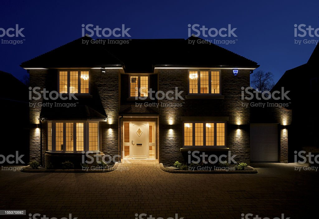 double fronted house at dusk stock photo