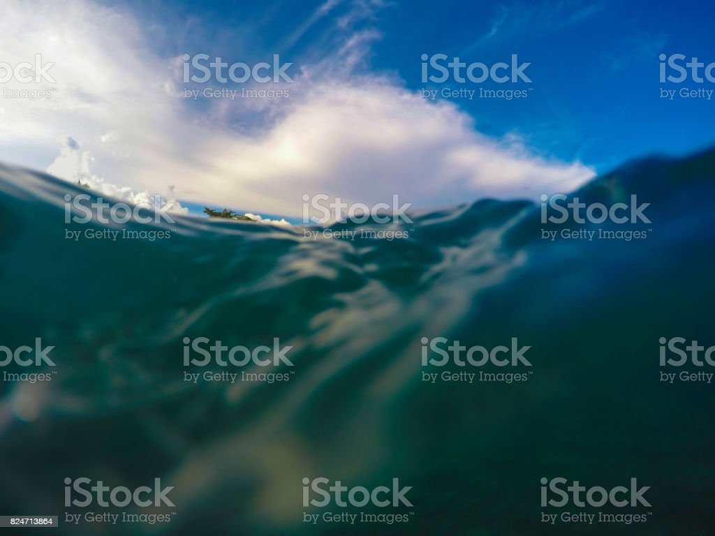 Double landscape with sea wave floating and splashing in front of camera stock photo