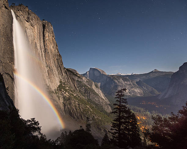 Double Moonbow over Yosemite Falls at night stock photo