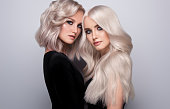istock Double portrait of blondes with different length of hair. Elegance, hairstyling and makeup.. 1262788782