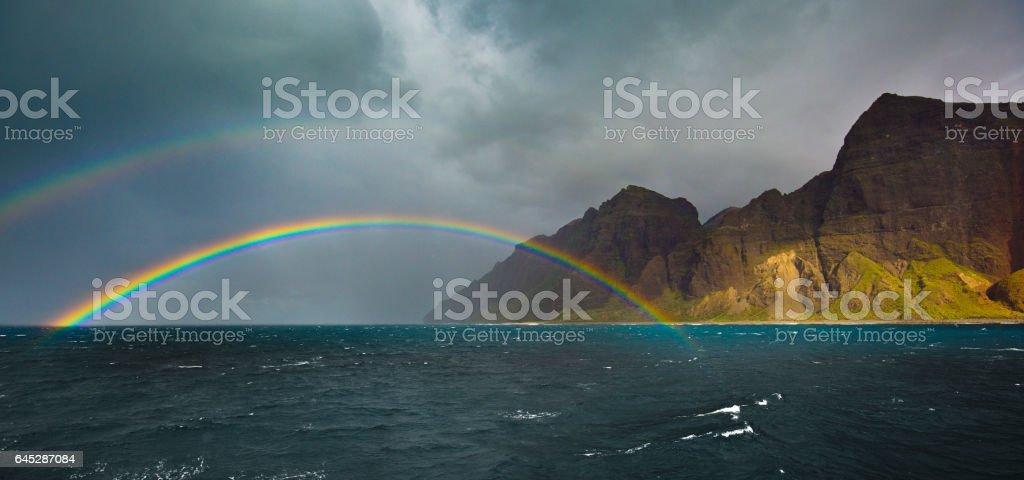 Double Rainbow at Na Pali Coast in Kauai, Hawaii stock photo