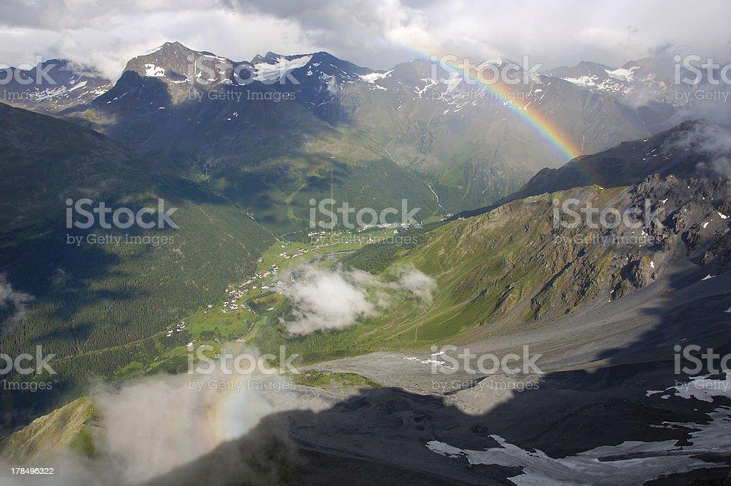 Double rainbow in the Alps stock photo