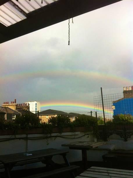 A double rainbow over London. stock photo