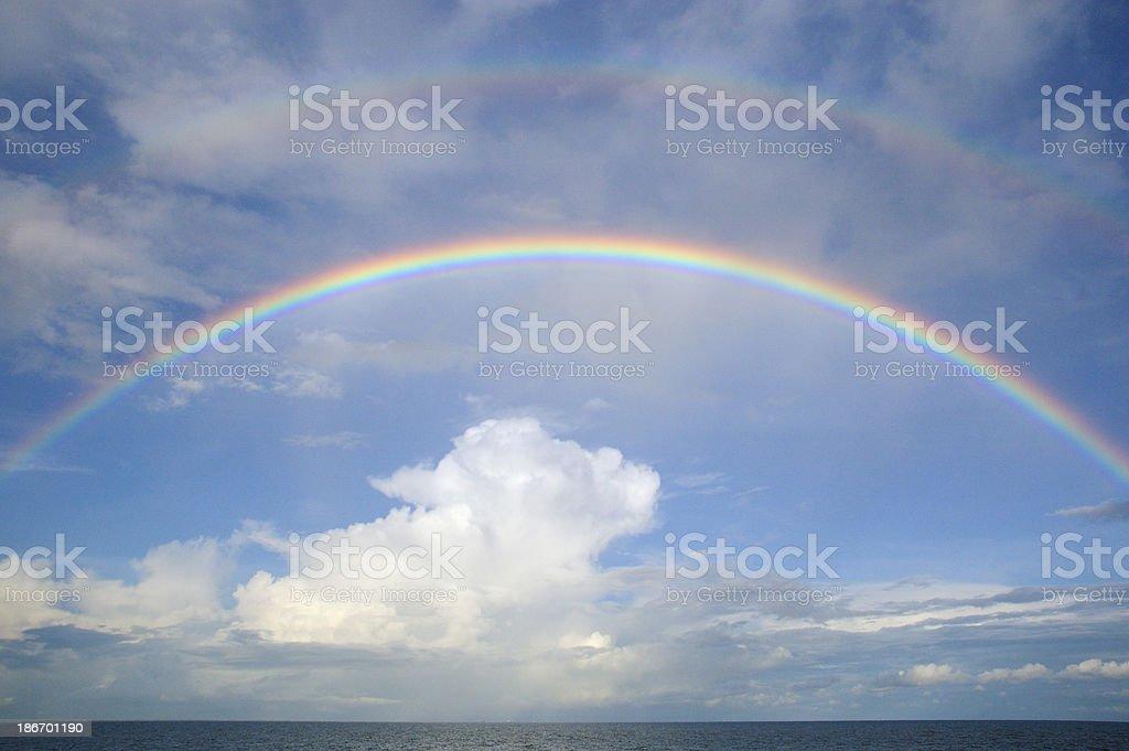 Double rainbow over sea stock photo