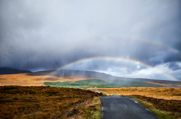 A double rainbow over the landscape in scotland A double rainbow over the landscape in scotland along the route of the north coast 500. The road leads through the landscape. north coast 500 stock pictures, royalty-free photos & images