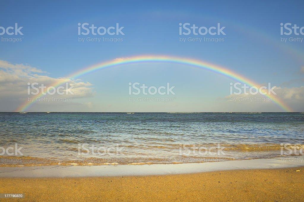 Double rainbow over the ocean by the beach stock photo