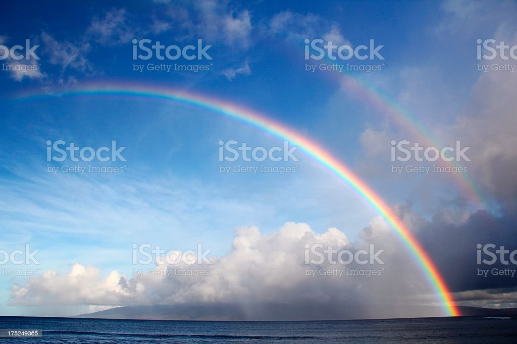 Double rainbow Pacific Ocean beach scene on Maui Hawaii stock photo