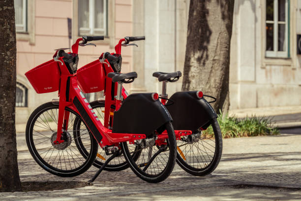 Double red Uber-Jump electric bicycle Lisbon stock photo