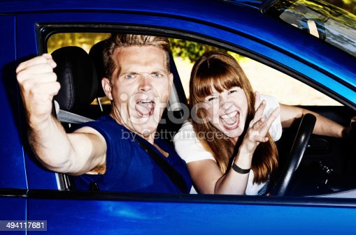 475395935istockphoto Double road rage! Couple in car yell furiously at someone 494117681