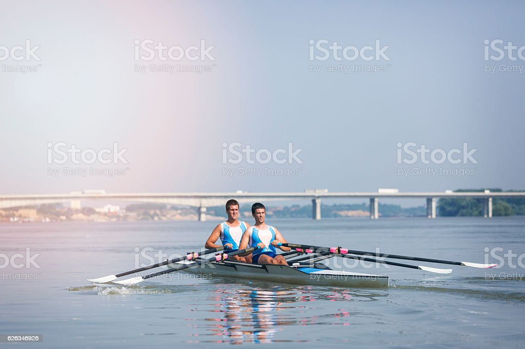 Double scull rowing on river stock photo