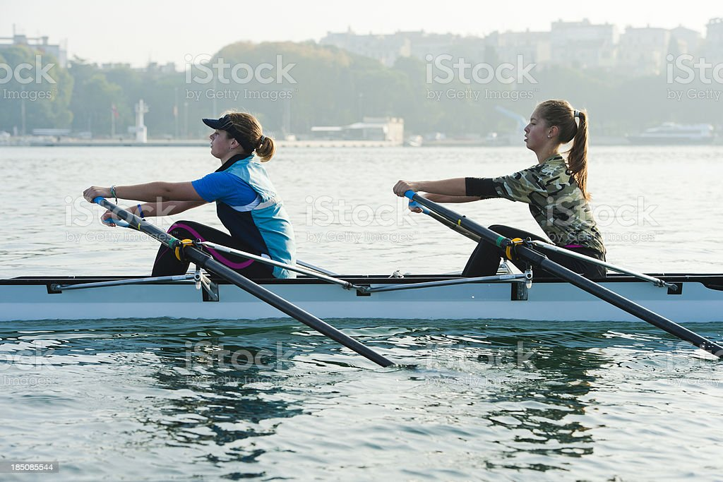 Double scull rowing team practicing royalty-free stock photo