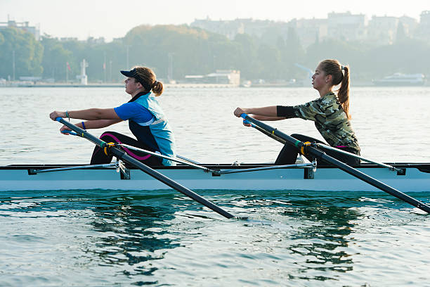 Double scull rowing team practicing stock photo