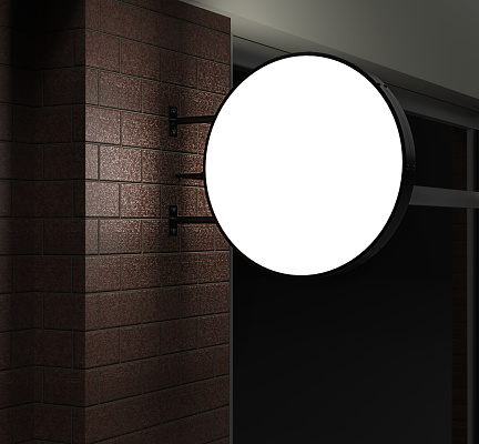Double sided Back lit signage circular board, led glow advertising board, vinyl company sign on brick wall.