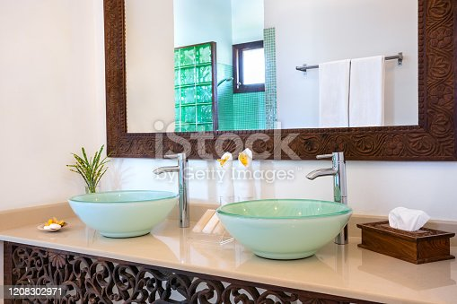 Double sink bathroom with large mirror in luxury villa (Zanzibar, Tanzania). Property released.