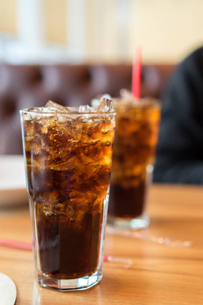 double soft drink carbonated fresh food soda, white dish on wooden table with handsome man sitting  brown sofa in pizzeria restaurant - gmail imagens e fotografias de stock