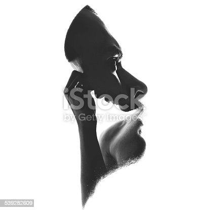 A double-exposure fine art portrait of taken from the same young thinking man, isolated on white background.