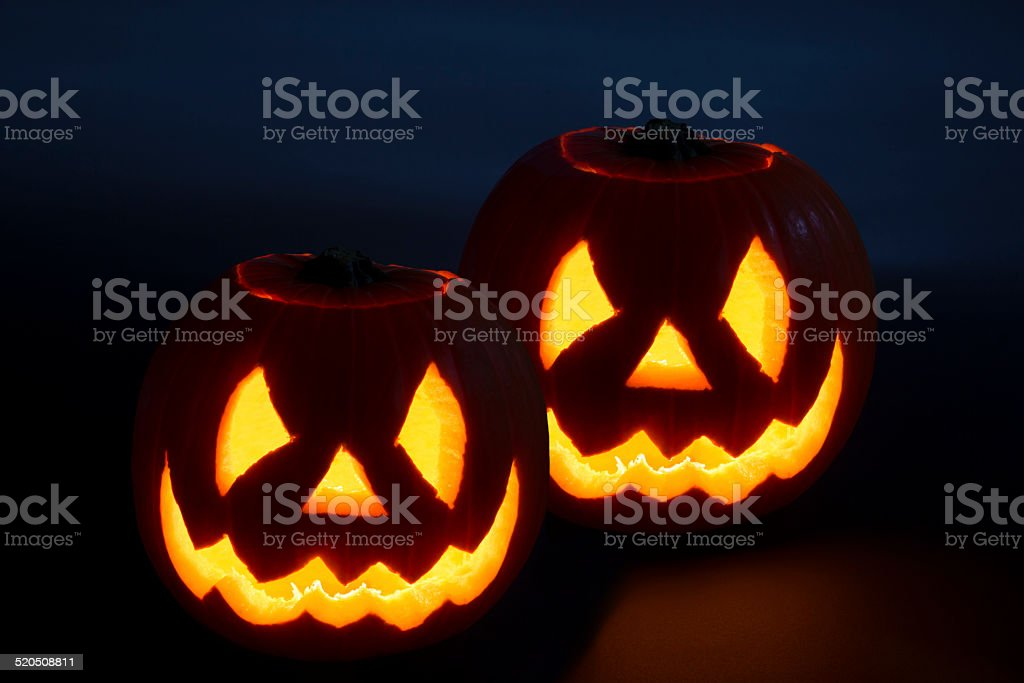 Double trouble halloween heads lit up stock photo