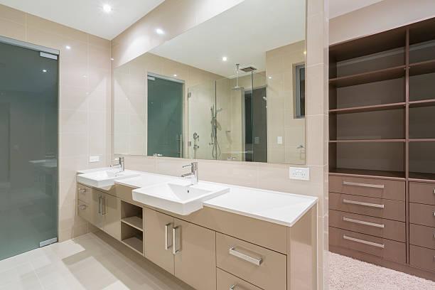 Double vanities and walk-in shower in a modern bathroom stock photo