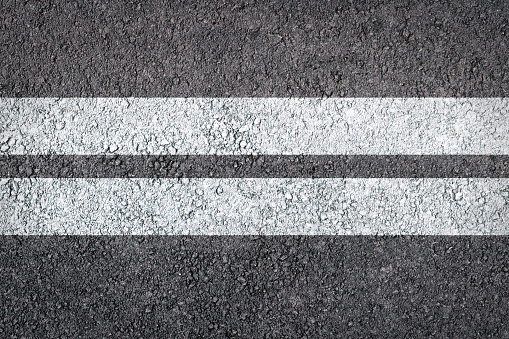 621693226 istock photo Double White Line On New Asphalt Road texture background 1135425826