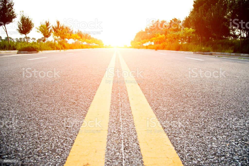 Double yellow lines on a road stock photo