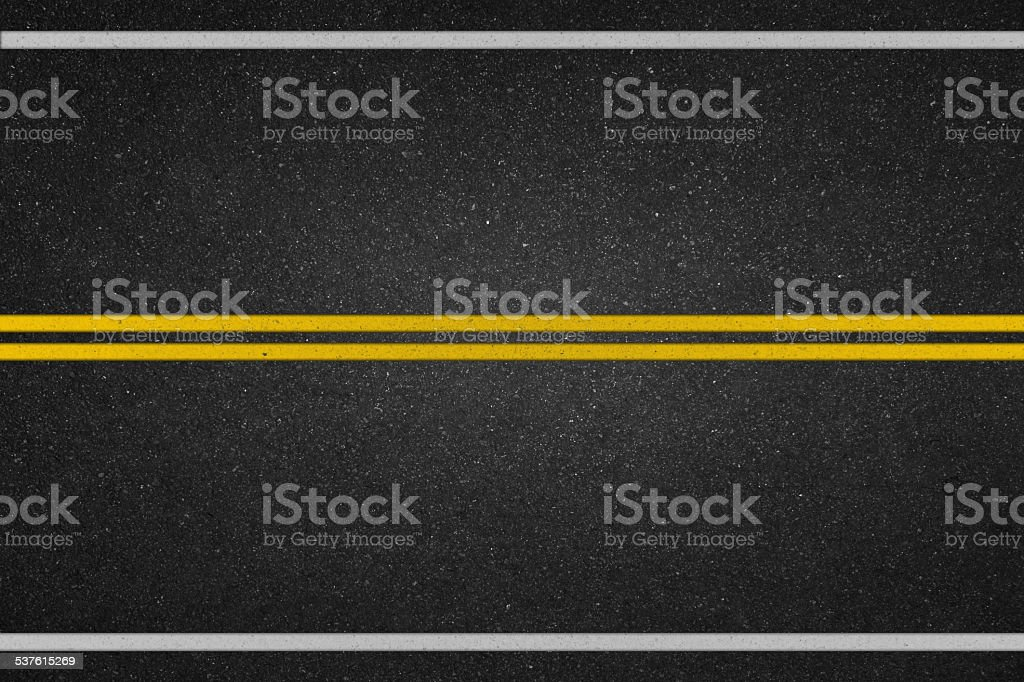 Double yellow lines on asphalt road stock photo