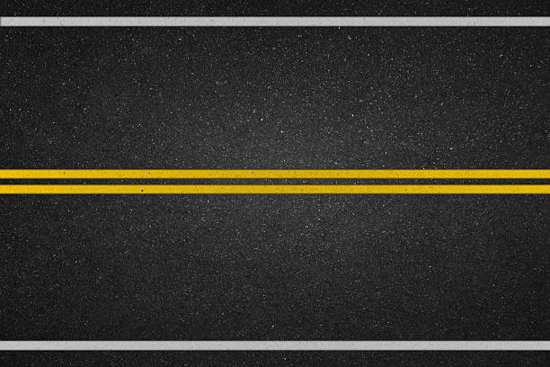 Double yellow lines on asphalt road Double yellow lines on asphalt road asphalt stock pictures, royalty-free photos & images