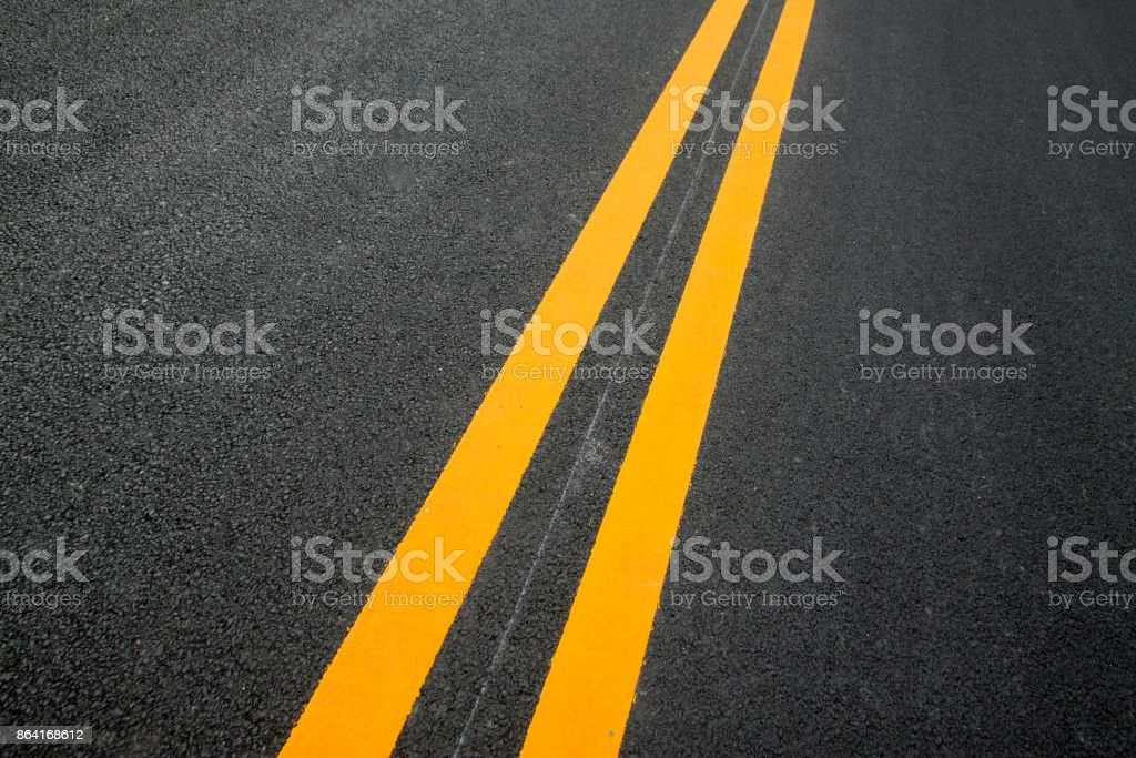 Double yellow lines on the asphalt road, closeup of photo royalty-free stock photo