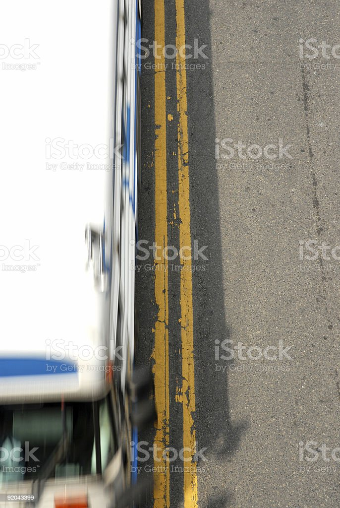 Double Yellow lines with Bus royalty-free stock photo