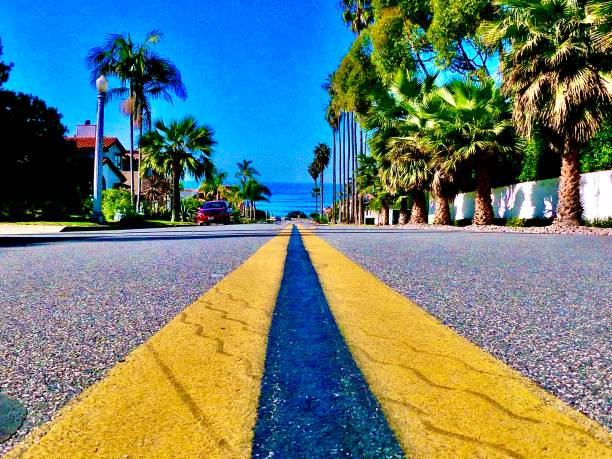 double yellow street lines driving in san diego, ca samuel howell stock pictures, royalty-free photos & images