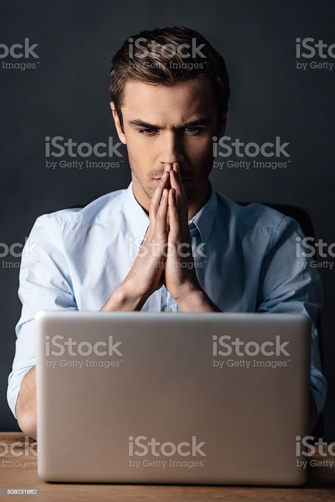 Double-checking his work. stock photo